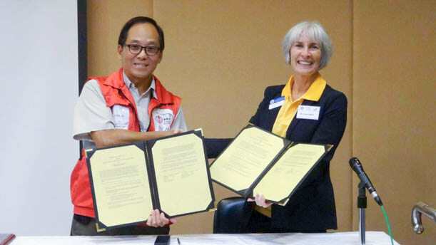 At the end of it all, a ceremony to sign a renewed agreement between Kapi'olani Community College and Dr. Jimmy Chan and the Hong Kong Association for Conflict and Catastrophe Medicine.